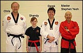 Master Yeoh, chief instructor Derek O'Connell, assistant instructor Chris Pollach and one of the higher belt students that also assist