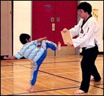 Master O'Connell teaches a young student to break a board for his frst time