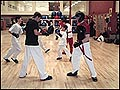 In front, Kurtis Oman (left) and Daivd Pollach (right) practice light warm-up drills before the sparring matches begin